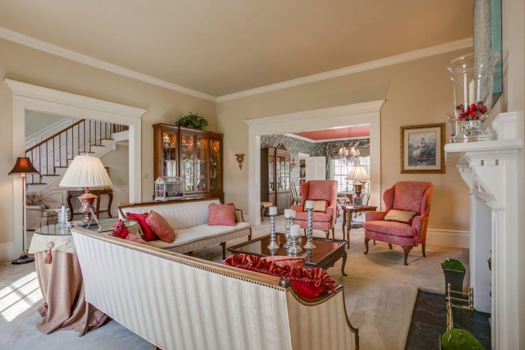 Spacious den with pinstriped furniture and Southern decor.